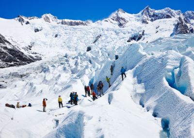 Tourists learning to grapple and rappel on Glacier Grande.